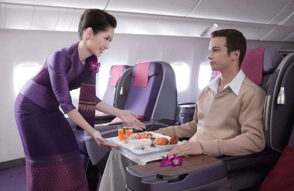 business class stewardess in-flight service