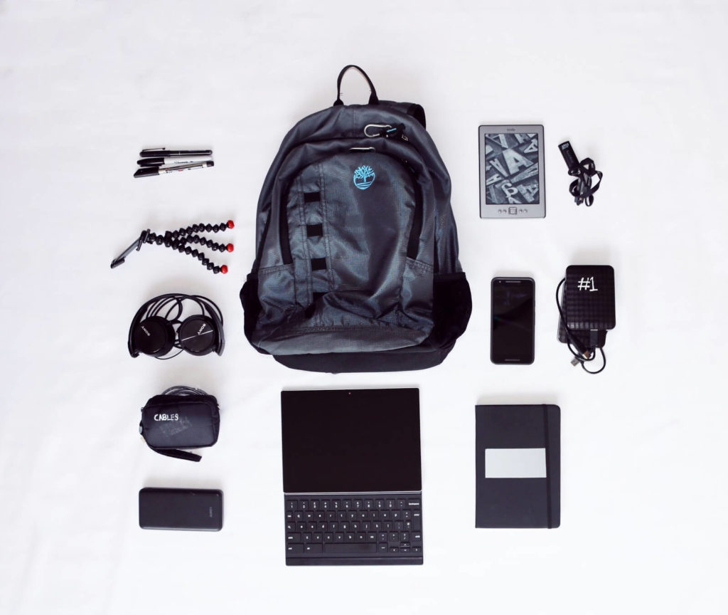 A business backpack with accessories. Such backpacks are one of the best carry on luggages for business travel.